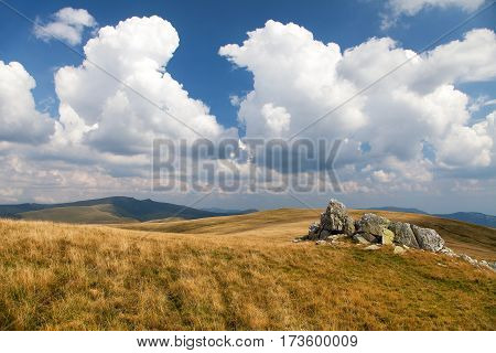 Mountain view from romanian Carpathi with clouds Vulcan mountains Romania