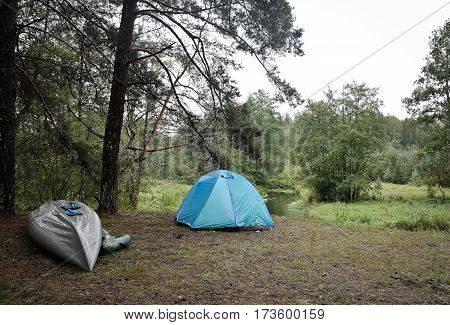 tourist camp in the woods with boat