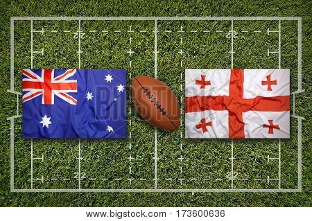 Australia vs. Georgia flags on green rugby field, 3 D illustration