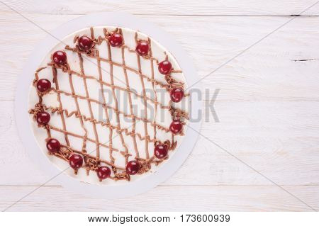 Chocolate cake with mousse, decorated with cherries and chocolate. Copyspace
