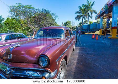Cienfuegos, Cuba - March 23, 2012: Rural Parking With Retro Ford Car