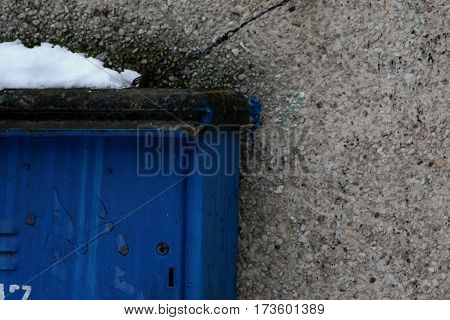 Cable hut cabin close up isolated on stoned wall covered with winter snow, beautiful black anf white background