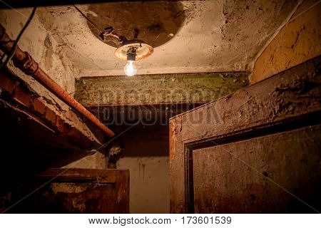 Grunge flap entrance with heavy weathered surfaces. One of many operational russian public dormitory.