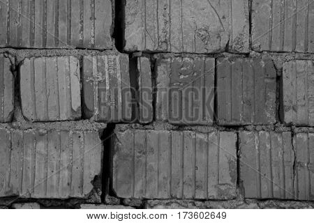 Red bricks background, old cracked wall in black and white style