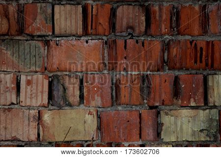 Red bricks background, old cracked wall, red background