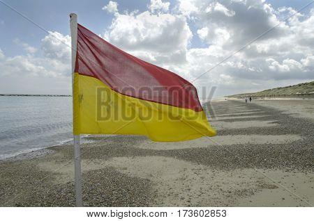 Life Guard flag on Sea Palling beach Norfolk UK.