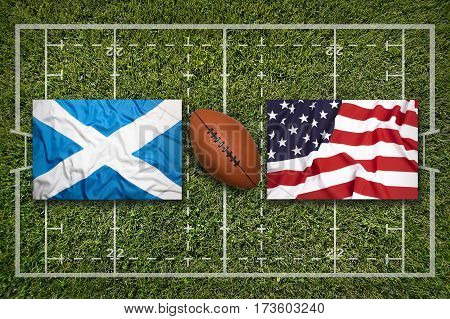 Scotland vs. USA flags on green rugby field, 3 D illustration