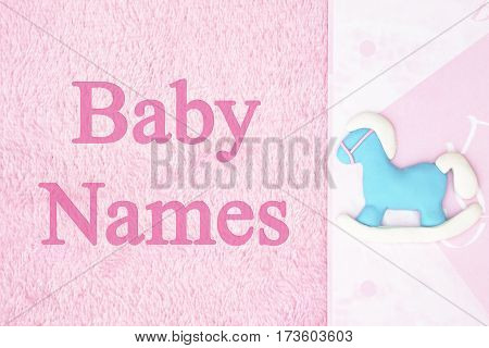 Old fashion pink baby names background with a hobby horse with text Baby Names