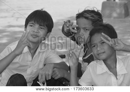 PHNOM KULEN CAMBODIA 03 27 13: Unidentified street children posing. Around 30% of the population lives below the poverty line in Cambodia, a country that is just recovering from a violent war