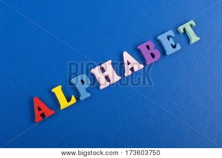 word on blue background composed from colorful abc alphabet block wooden letters copy space for ad text. Learning english concept