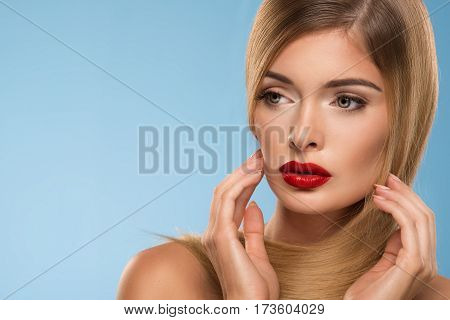 Portrait Of Beautiful Young Sexy Woman With Red Lips, Over Blue Background