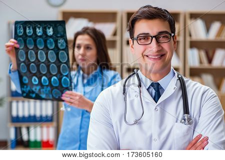 Young doctor looking at computer tomography x-ray image