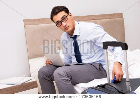 Businessman working during business trip in hotel