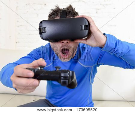 young modern man at home living room sofa couch playing video game excited using 3d goggles watching 360 virtual reality vision enjoying the fun cyber experience in vr simulation reality concept