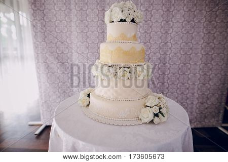 on the table is a large white wedding cake