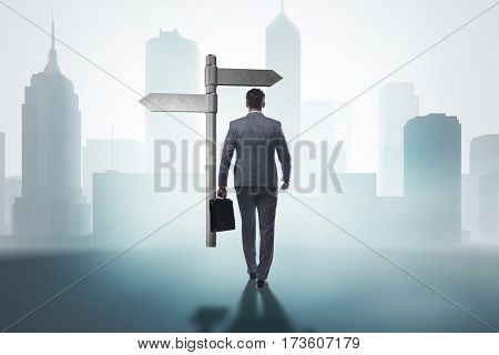 Businessman in difficult choice concept