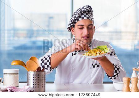 Man preparing food at the kitchen