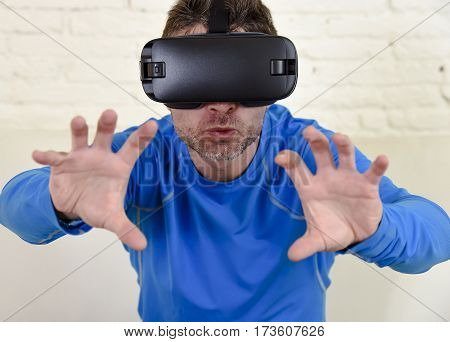 young modern man at home living room sofa couch excited using 3d goggles watching 360 virtual reality vision enjoying as if touching virtual woman brest in cyber sex experience vr simulation reality