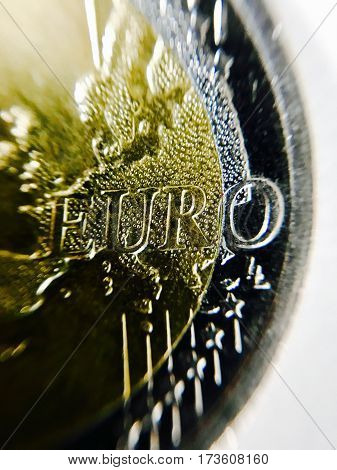 Closeup of EURO coin on white with shallow depth of fields, EURO clearly readable