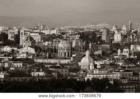 Rome rooftop view with ancient architecture in Italy monochrome.