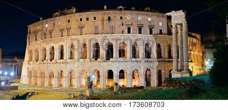 Marcelloâ??s Theatre with historical ruins at night in Rome, Italy