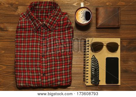Something for outdoors adventure in retro style - chekered shirt scetchbook cell phone jackknife wallet and sunglasses