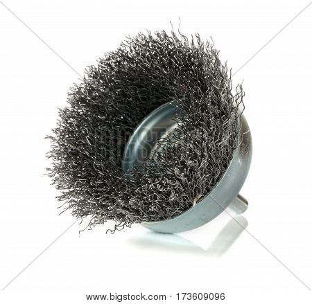 metal brush on a drill to remove rust isolated on white background.