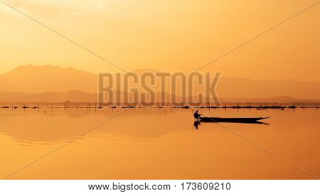 Beautiful sunset in southeastern asia with traditional boat