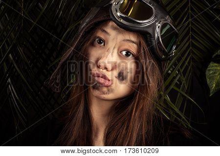 attractive young girl grimacing face in studio