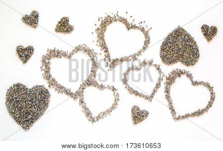 beautiful colorful heart of beads on a white background celebration love concept
