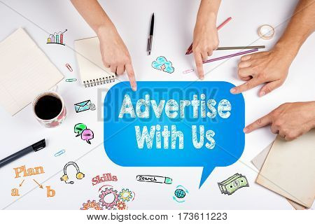 Advertise With Us. The meeting at the white office table.