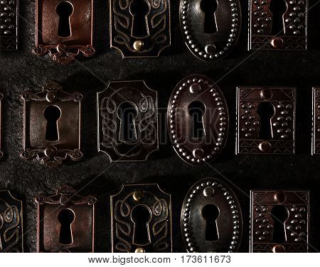 Assorted vintage locks in a row on dark background