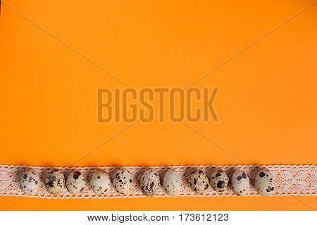Quail Eggs On The Orange Background