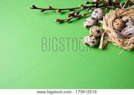 Quail Eggs In A Straw Nest On The Green Background