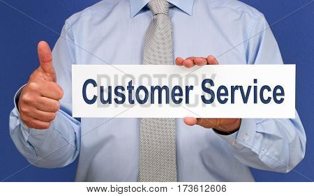 Customer Service - Businessman with sign and thumb up