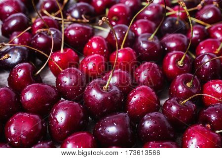 Sweet summer berries. Fresh berries. Berries on the table.Background of ripe red cherries with water drops. Healthy eating. The texture of berries.