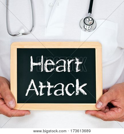Heart Attack - Doctor holding chalkboard with text