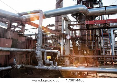 steel pipes on industrial enterprises in sun lights