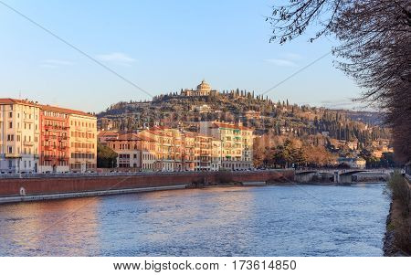 historical quarter of Verona, sunny view from river on fort San Leonardo, Italy