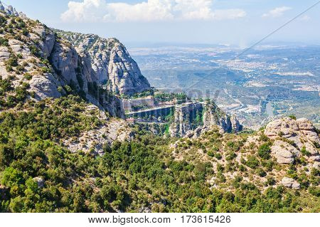 View of the Monastery of Montserrat in Catalonia, near Barcelona. Panoramic view on the opposite mountain