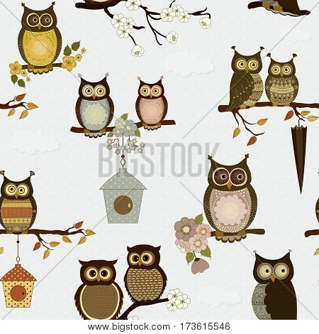Seamless pattern with cute cartoon owls in vector