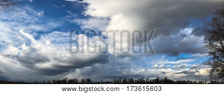 Beautiful white clouds soar across the screen over a deep blue background.