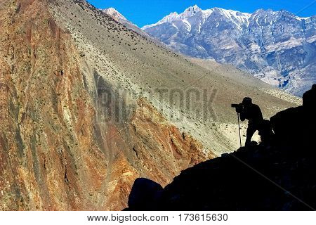 Man photographing mountains in Nepal. Kingdom of Mustang. Himalayas.