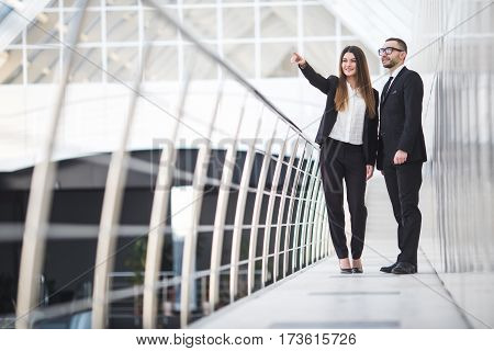 Businessman And Businesswomen having informal meeting in office and discussing plans