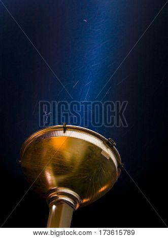 spotlights shining in the night sky Outdoor sport court or stadium lights against dark night sky