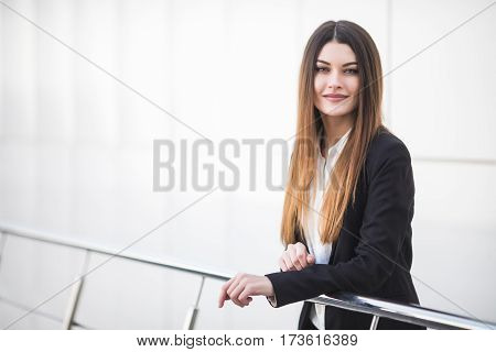 young business woman at office balcony smile