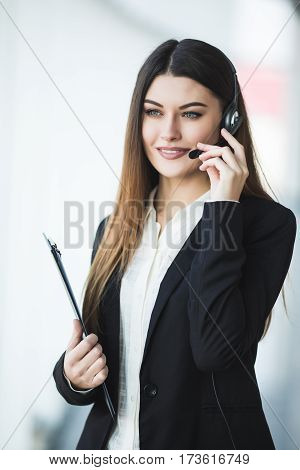 Portrait of happy smiling cheerful support phone operator in headset on office