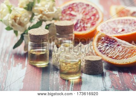 Essential Oil Citrus  With Orange Slices,  In Glass Bottle On Ol