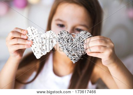 little girl keeps in hands hearts. recreation game