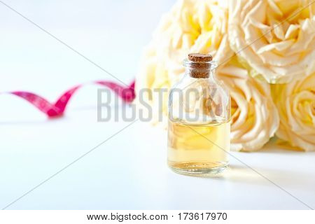 Glass Jar With Rose Water And Aromatherapy, Copy Space For Text.